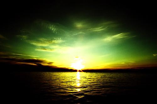 sunset sky sun film water tag3 taggedout clouds canon washington xpro tag2 tag1 kodak ae1 crossprocess wideangle flare 24mm kirkland e100vs letsplaytag ae1program theworldthroughmyeyes dnutatafeature houghtonbeach