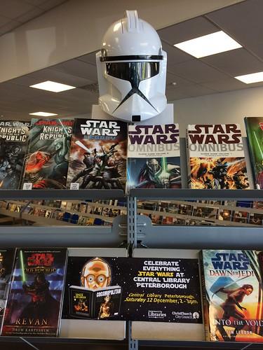 Clone trooper helmet and books