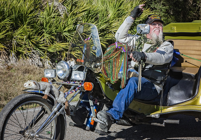 Biker participates in the People's Parade during Mardi Gras in Dauphin Island, Alabama