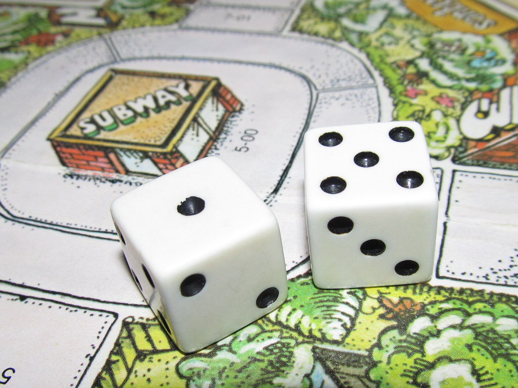 Pair of Dice on Game Board