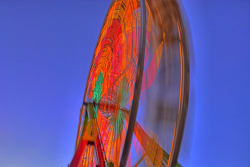 show longexposure carnival blue sunset red orange motion color wheel kids night oregon fun outdoors lights amusement fairgrounds nikon ride bright outdoor statefair spin fast bluesky fair september entertainment riding enjoy spinning wife handheld ferriswheel amusementpark rides salem bluehour midway magical hdr laborday thrill oregonstatefair kirt 2015 roundnround funtastic salemoregon gaylene easyhdr magicalhour fairatnight edblom nikond7100 kirtedblom