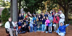A large group of North Raleigh Rotarians and their families volunteered their time on Saturday, October 31, 2015 to walk the paths around Shelley Lake and pick-up trash.