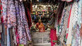 Woman Purchases Clothes at Market | by World Bank Photo Collection