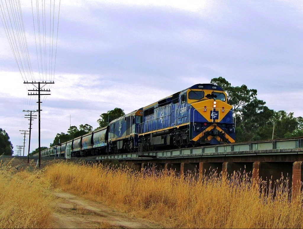 C508+GL106 rumble out of Glenorchy with a loaded grain train operated by Qube Logistics by Adam Serena