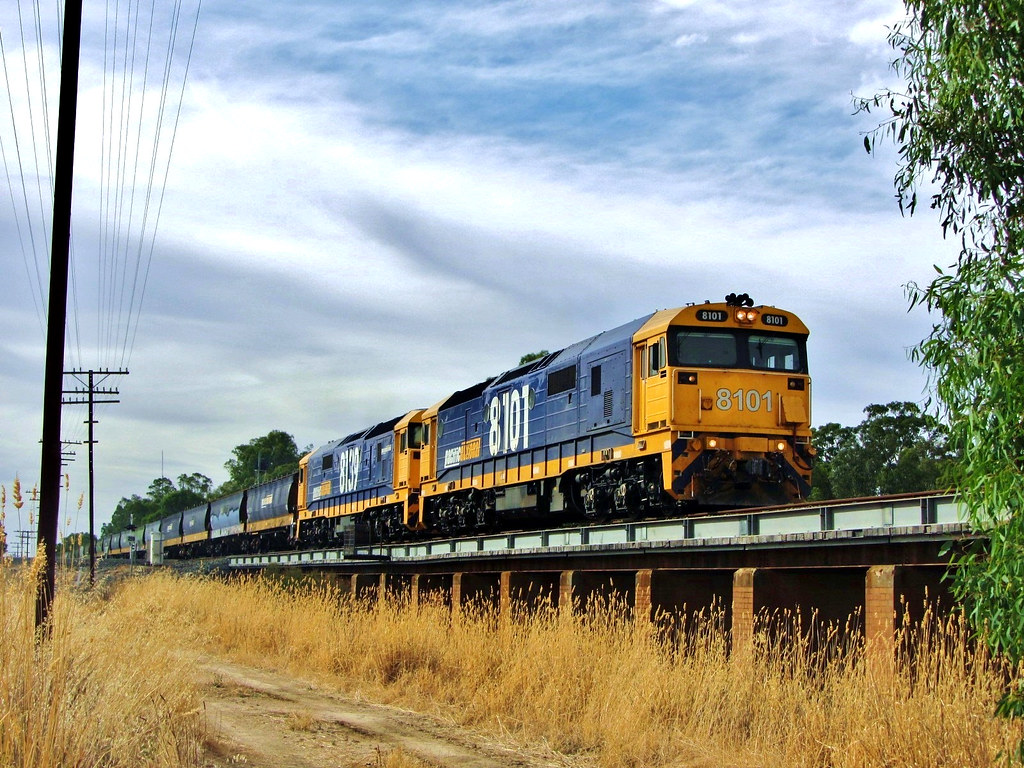 8101+8139 speed Eastbound out of Glenorchy with a 50 wagon loaded grain train by Adam Serena