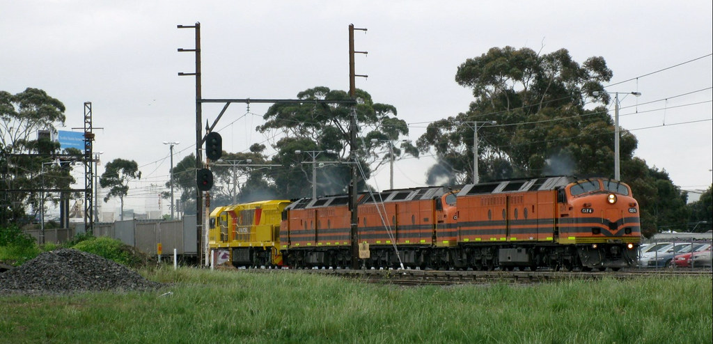 CLF4+CLP12+CLF3 tow brand new locomotive ACB4401, along with their SM9 freight service at Albion by Adam Serena