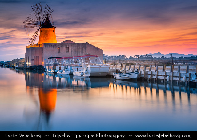 Italy - Sicily - Salina - Windmills at Stagnone di Marsala in front of Mozia Island - Salt plant in the area of Trapani - Sunset