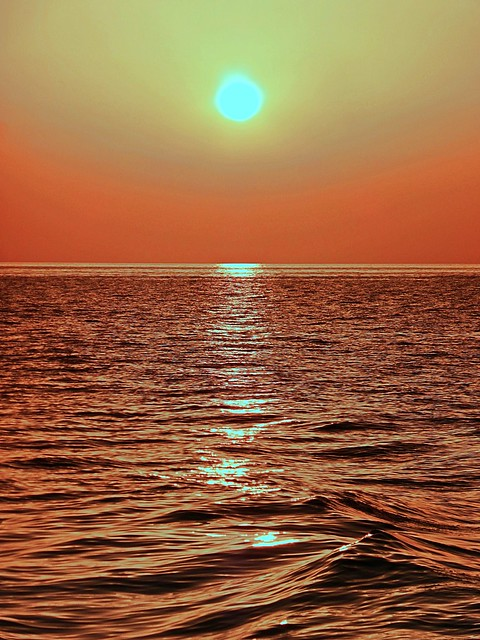 Setting sun over the lapping waves