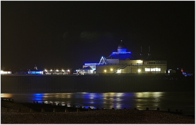 Nightime reflection of the pier at Christmas