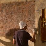 Restoration of Armenian script in chapel by Italians.
