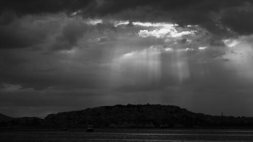 athens greece sea lightbeams blackwhite bw monochrome canoneos5dmarkiii ef100mmf28l kastella boats sun clouds landscape