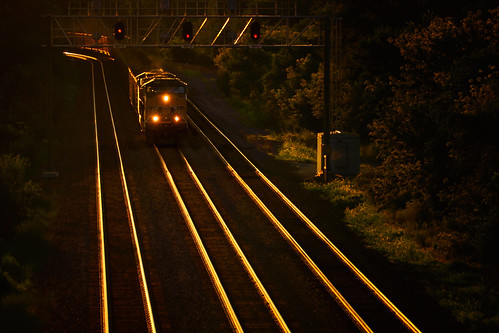 freighttrain locomotive headlights unionpacificrailroad uprr genevasubdivision sunset evening goldenhour dusk tracks rails patterns glow glowing wheatonillinois dupagecounty chicagoland summer july converginglines diminishinglines trees foliage flora signals signalbridge coaltrain unittrain 5745 sd70m up5745 aerial elevated lincolnmarsh transportation symmetry linear parallel eastbound loaded heavy weight horsepower landscape nikond5100 tamron18270 photoshopbyfehlfarben thanksbinexo
