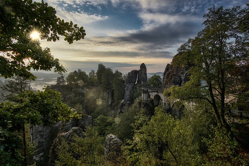 basteibrücke sächsischenschweiz cliff cliffs stones boulders rocks trees high morning sunrise colors parchmankid sony a6000 samyang 12mm wide angle atmosphere fog saxony germany sächsischen schweiz landscape jerryburchfield burchfield saxon lens flare lensflare proudliberal liberal freedom democracy fineart art liberalblinks