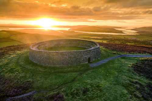 grianan aileach lough swilly foyle ancient irish kings hill lookout fort ring ringed burt county donegal ireland summer landmark stone brick monument tourist tourists site famous visit scenic countryside druid celtic gareth wray photography strabane hdfox hd fox inishowen derry londonderry an angrainan blue sun inch island historic aerial drone dji phantom 3 quadcopter heather national gaelic photographer garethwrayphotography vacation holiday europe fahan buncrana people kingdom outdoor architecture landscape