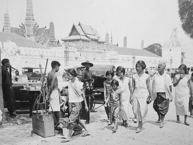 Pedestrians and street vendors just outside the Grand Palace