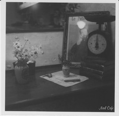 still life with a scale (秤のある静物画) by Noël Café