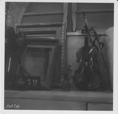 still life with a violin (バイオリンのある静物画) by Noël Café