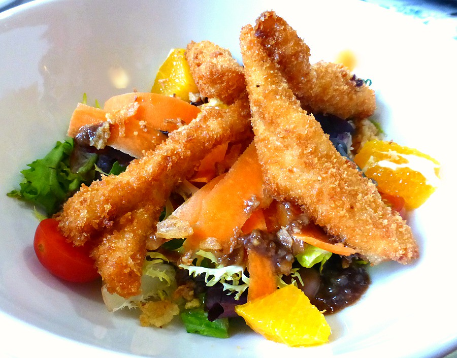 Fried chicken tends atop fresh salad