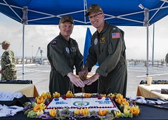 Capt. Kenneth Strong, left, and Capt. Scott Miller cut a cake after the USS New Orleans (LPD 18) change-of-command ceremony. (U.S. Navy/MC2 Kelby Sanders)