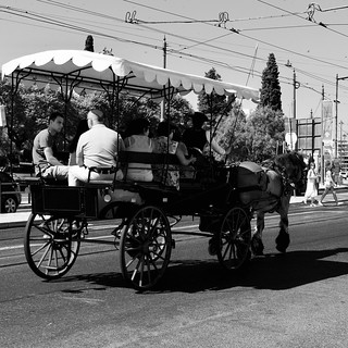 A touristic sightseeing horse-drawn cart