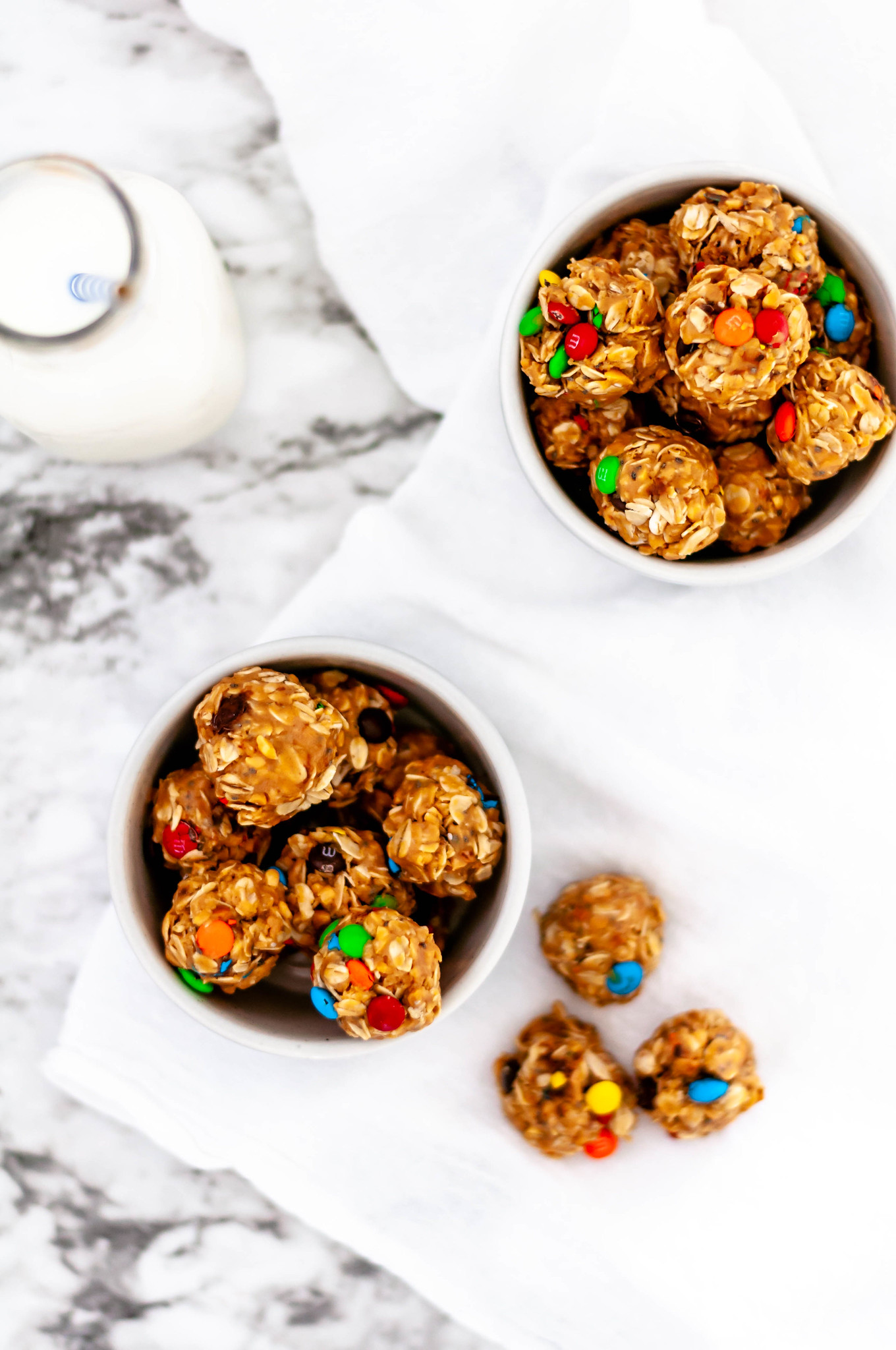 Monster Cookie Energy Balls are a simple, healthy snack that will fix your sweet tooth without wrecking healthy eating habits. Tastes just like a monster cookie, but healthy.