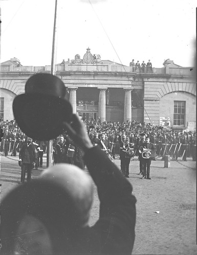theclonbrockphotographiccollection lukegeralddillon baronclonbrock augustacarolinedillon baronessclonbrock dillonfamily nationallibraryofireland proclamation kingedwardvii queenvictoria princeofwales courthouse band military pompandceremony galway townhall courthousesquare townhalltheatre flagpole square crowds locationidentified