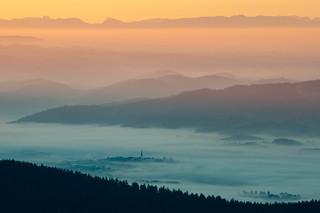 2 churches peeking through the mist