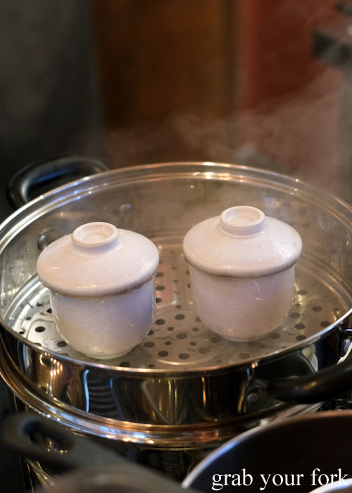 Chawanmushi in the steamer, part of the omakase sushi menu at Osaka Bar in Darlinghurst Sydney