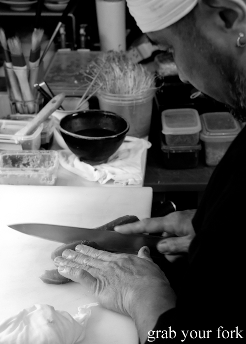Chef Kazu Nakatani slicing blue fin tuna for his omakase sushi at Osaka Bar in Darlinghurst Sydney