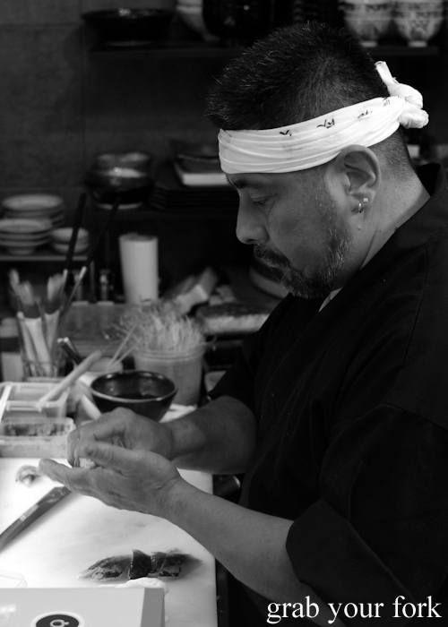 Chef Kazu Nakatani making nigiri sushi for his omakase sushi menu at Osaka Bar in Darlinghurst Sydney