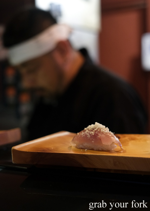 Yellow tail nigiri sushi with soy bean powder on the omakase sushi menu at Osaka Bar in Darlinghurst Sydney
