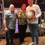 Young Player of the Year Euan Storrier is presented with his award by Brian & Joyce Dunbar