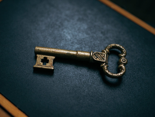 Old royal key with a cross-shaped hole