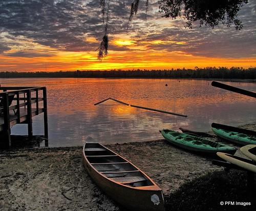sunrise lake canoe kayak water clouds shadows trees dock sand beach florida sun orange light outdoor landscape waterscape canon powershot g10 nature beauty