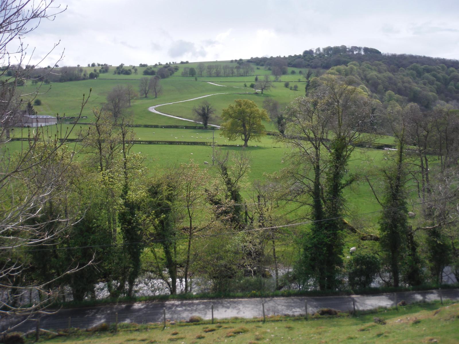 Road across the Manifold River towards Hazelton Clump SWC Walk 326 - Dovedale (Ashbourne Circular)