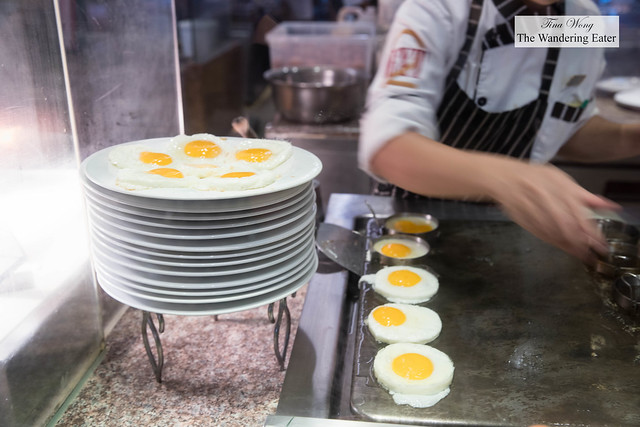 Frying sunny side eggs at Next2 Cafe