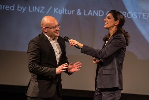 CE19 - Award Ceremony // Almir Balihodzic (communal councillor), Moderator Karin Schmid //  photo © Christoph Thorwartl / subtext.at