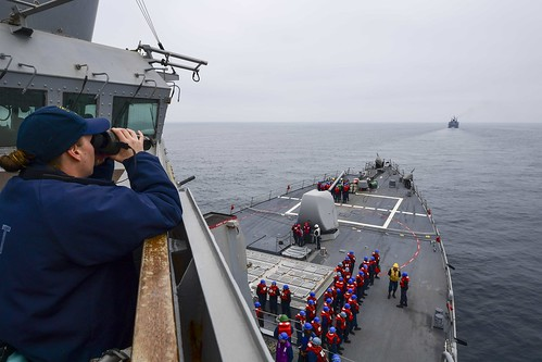 A Sailor measures the distance from USS Ross (DDG 71) to the Turkish Navy ship. | by Official U.S. Navy Imagery