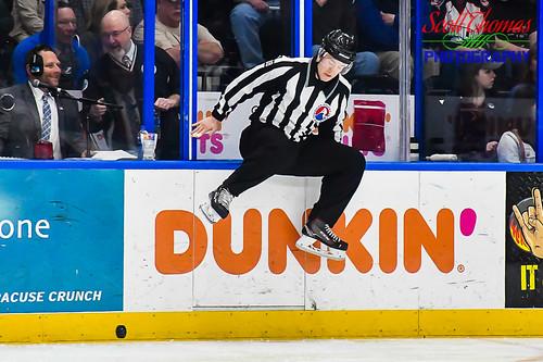 ahl americanhockeyleague caldercup cleveland crunch icehockey linesman monsters newyork onondagacounty playoffs pro professional sports syracuse tysonbaker warmemorial unitedstatesofamerica nikond500 nikon18140mmf3556vr jump jumping skates puck