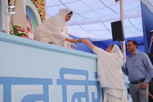 Satguru Mata Ji Releasing the Samagam Souvenir