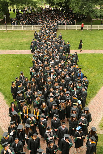 Graduates line up at the Wren Building for the walk across campus.
