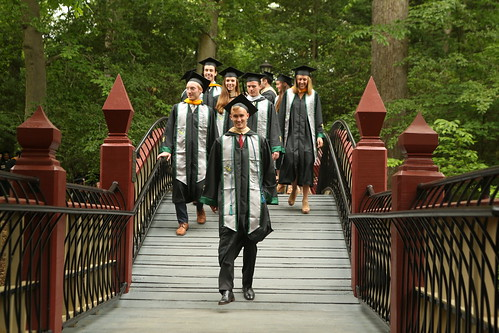 Students cross the Crim Dell bridge on the way to the Commencement ceremony.