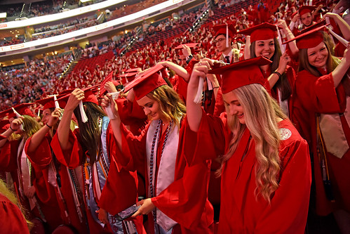 Students turn their tassels.