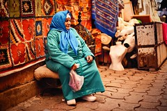 An elderly woman with blue scarf