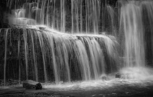 sonyalpha sonya7rm2 ilce7rm2 mirrorless rock water waterfall monochrome bw blackandwhite minnesota nerstrandbigwoods statepark park nature