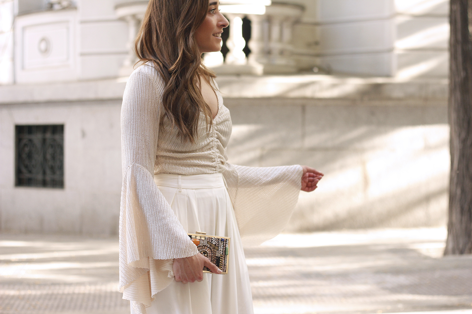 look de invitada lola casademunt white palazzo pants golden top street style outfit 20199