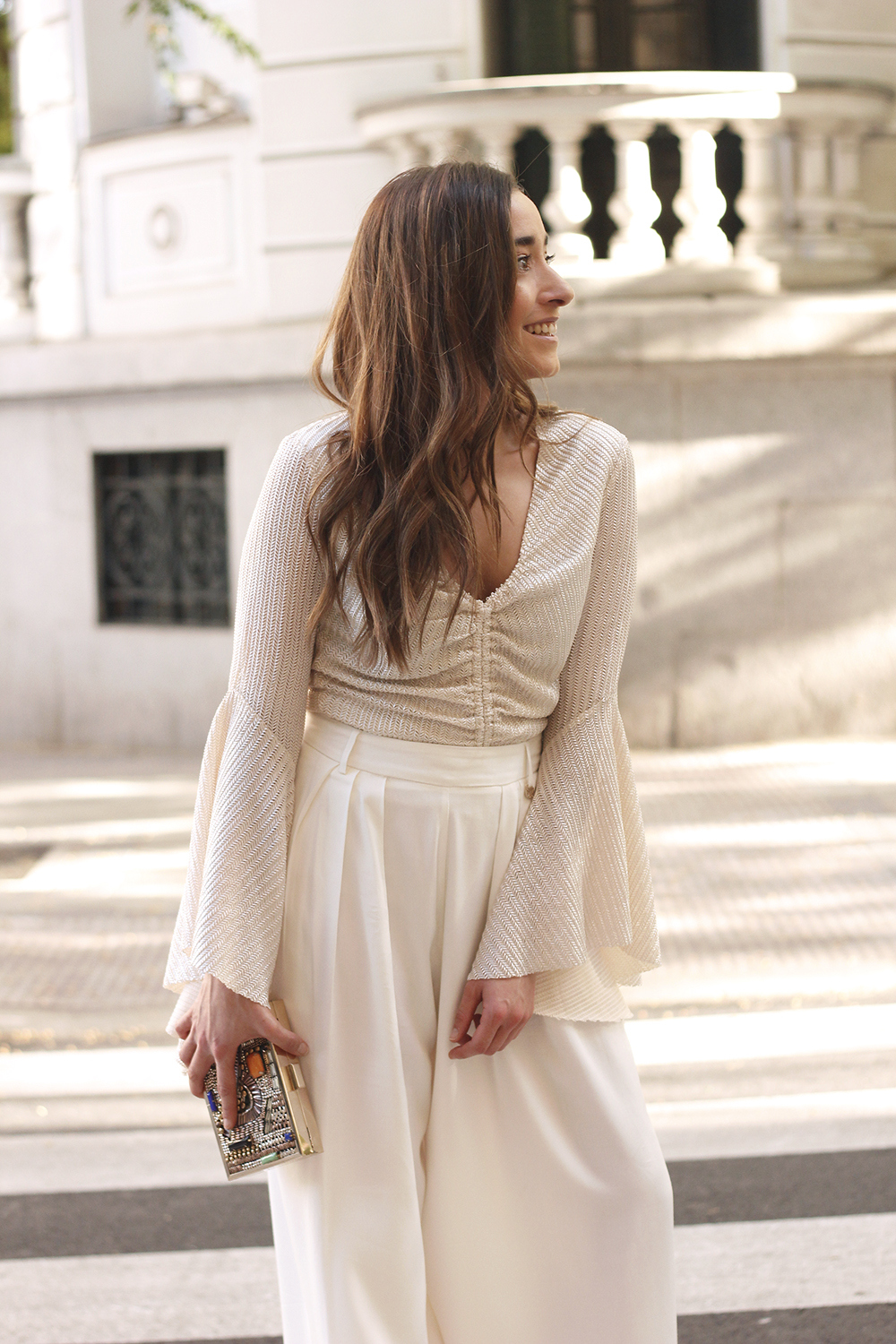 look de invitada lola casademunt white palazzo pants golden top street style outfit 20198