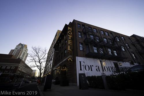 dean hotel providence rhode island backlit sunrise city urban street writing wall light old style