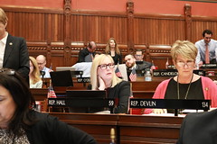 Rep. Hall listens to debate in the House Chamber