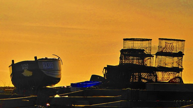 Boat and lobster pots in the morning glow